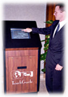 TouchGuide's inventor, Mark Metz, demonstrates a unit in a hotel lobby